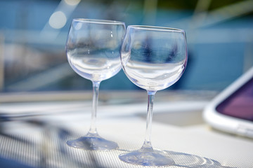 Pair of wineglasses against the yacht