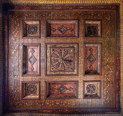 Ottoman era decorated wooden ceiling with golden floral pattern decorations at historic House of Egyptian Architecture, located in Darb El Labbana district, Cairo, Egypt