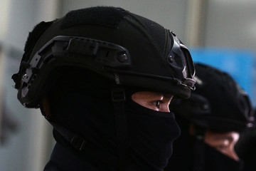 Special police forces wearing helmets are seen during a news conference at Office of the Narcotics Control Board in Bangkok