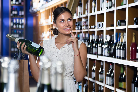 woman buying wine in a winery