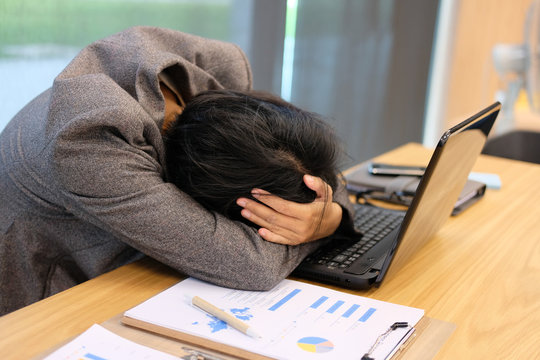 woman put hand on head feeling tired, frustrated & stressed from hard work. exhausted businesswoman have headache at workplace.