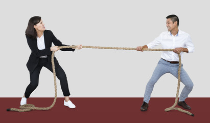 Diverse people tugging on a rope
