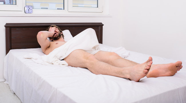 Male reproductive system. Why men get morning erections. Normal erections occur. Macho sexy guy torso relaxing lay bedroom. Morning wood formally known nocturnal penile tumescence common occurrence