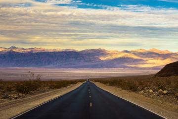 Empty road running through Death Valley