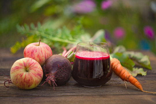 beet juice in glass on  table
