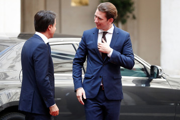 Austrian Chancellor Sebastian Kurz (R) arrives to meet Italian Prime Minister Giuseppe Conte at Chigi palace in Rome