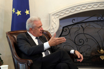 European Commissioner for Migration, Home Affairs and Citizenship Dimitris Avramopoulos talks during a meeting with Cypriot President Nicos Anastasiades at the Presidential Palace in Nicosia