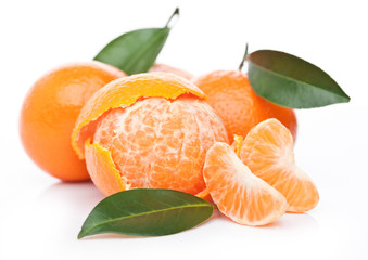Fresh organic peeled mandarin fruit with leaves