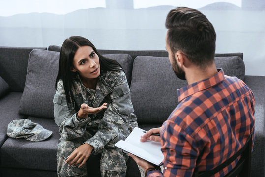 angry female soldier with ptsd talking to psychiatrist at therapy session