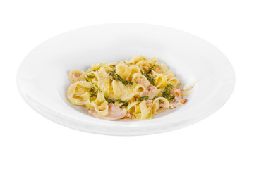 Pasta, noodles with bacon and sauce pesto, decorated with cheese. Side view. Serving a meal in a cafe, restaurant. Isolated white