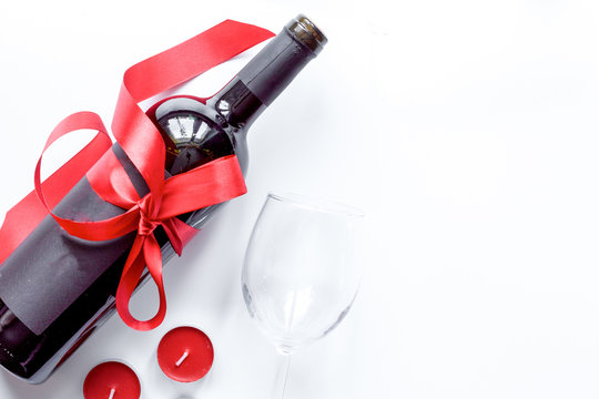concept Valentine Day with wine at white background top view