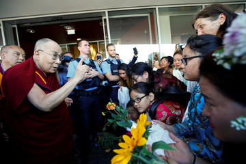 Tibetan spiritual leader the Dalai Lama speaks to Tibetans as he arrives at a hotel in Darmstadt