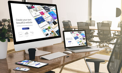 computer, laptop, tablet, and phone with responsive website builder at office mockup