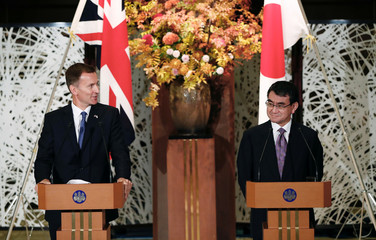 British Foreign Secretary Jeremy Hunt and Japanese Foreign Minister Taro Kono attend their joint news conference in Tokyo