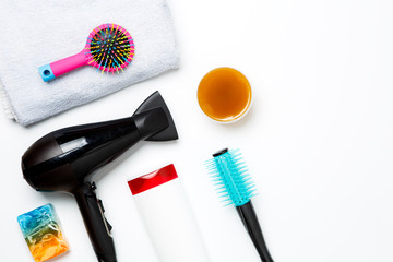 Photo of hair dryer, comb, scissors, towels, soaps isolated on white background.