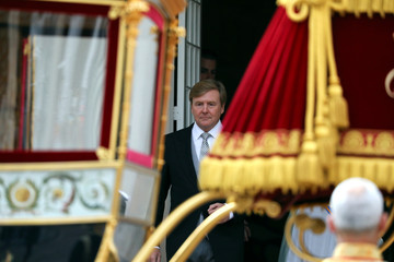Dutch King Willem-Alexander leaves the Noordeinde Royal Palace before the official opening of the new parliamentary year, in the Hague