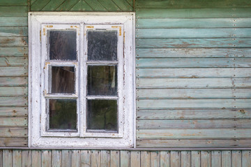 The old window of old wooden house. Background of wooden walls.