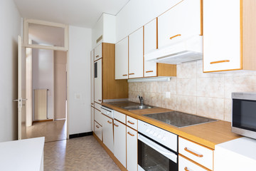 White and wooden vintage kitchen with tiles