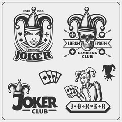 Set of casino and poker emblems and labels with Joker and playing cards.