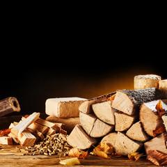 Dried logs, pellets and blocks of sawdust