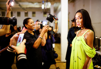 Model Winnie Harlow prepares backstage of the Natasha Zinko catwalk show during London Fashion Week in London
