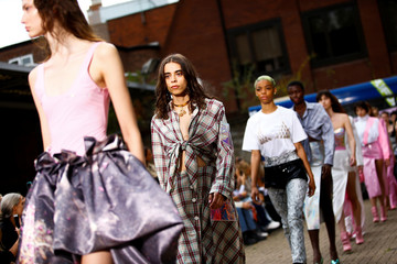 Models present creations during the Natasha Zinko catwalk show during London Fashion Week in London