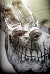 Vials on a skull, conceptual image