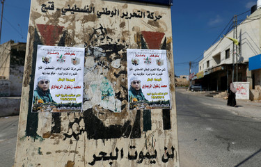 Pictures of 24-year-old Palestinian Mohammad al-Khatib are seen in Beit Rima village in the occupied West Bank