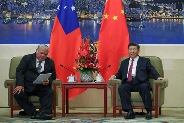 Samoa's Prime Minister Tuilaepa Lupesoliai Sailele Malielegaoi meets with China's President Xi Jinping at The Great Hall Of The People in Beijing, China