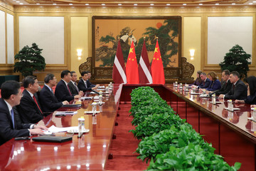 Latvia's President Raimonds Vejonis attends a meeting with China's President Xi Jinping at The Great Hall Of The People in Beijing, China
