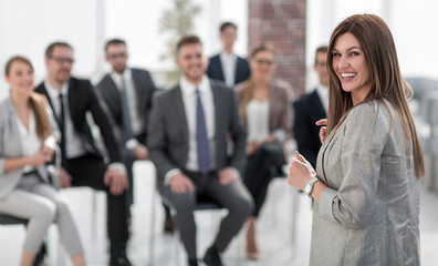 young business woman standing in conference room
