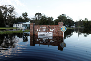 The entrance sign to Fair Bluff is surrounded by flood waters in the aftermath of Hurricane Florence in Fair Bluff