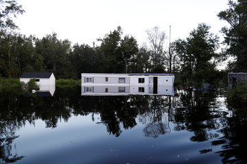 A mobile home is surrounded by flood waters in the aftermath of Hurricane Florence in Fair Bluff