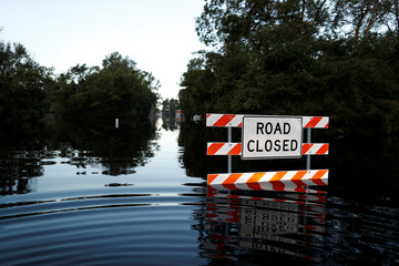 State Road 76 is blocked by flood waters in the aftermath of Hurricane Florence in Fair Bluff