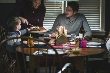 Family eating latkes