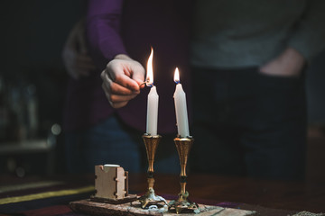 Man and woman lighting candles