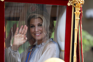 Queen Maxima waves as she arrives at the Noordeinde Royal Palace in the Hague