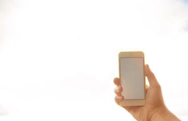 a man is holding a phone with a white screen