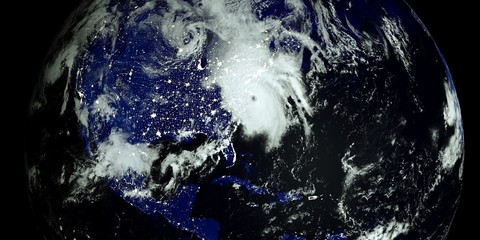 Extremely detailed and realistic high resolution 3D illustration of a Hurricane at Night hitting the US East Coast. Shot from Space. Elements of this image are furnished by Nasa.