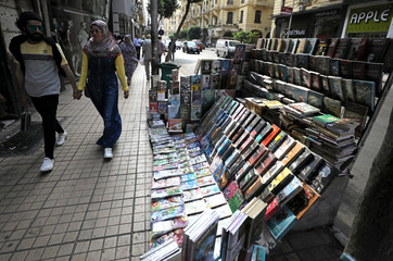 Books are seen along a street in downtown Cairo