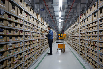 An employee works at an Amazon Fulfillment Centre (BLR7) on the outskirts of Bengaluru