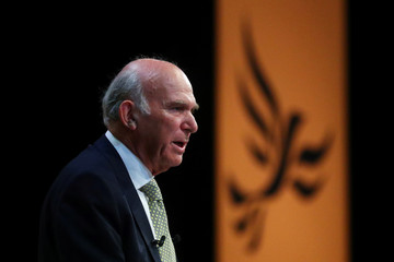 The leader of the Liberal Democrats, Vince Cable, addresses his party's annual conference in Brighton
