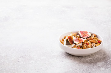 Muesli with Nuts Yogurt and fresh Figs on the gray Background.Granola Healthy Breakfast. Sweet food Dessert. Snack  Dry Diet Nutrition Concept.Copy space for Text