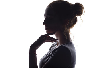 profile of beautiful girl with hand-picked hair, silhouette of a woman on a white isolated background
