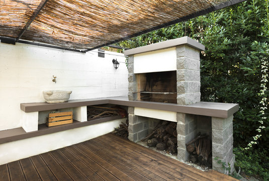 Modern outdoor kitchen covering with resin