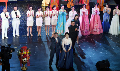 South Korean President Moon Jae-in, his wife Kim Jung-sook, North Korean leader Kim Jong Un and his wife Ri Sol Ju, come down to the stage after  the art performance at Pyongyang Grand Theatre in Pyongyang