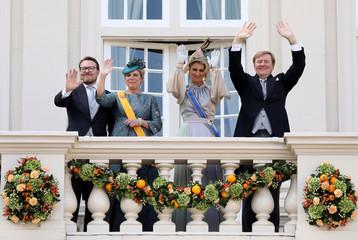 Dutch King Willem-Alexander, Queen Maxima, Prince Constantijn and Princess Laurentien wave from the balcony of Noordeinde in The Hague