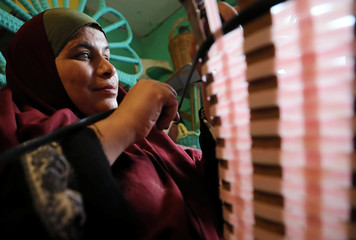 Heba Mahmoud, who is visually impaired, weaves bamboo baskets in Cairo