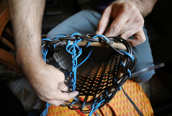 Samir Ragab, who is visually impaired, weaves bamboo baskets in Cairo