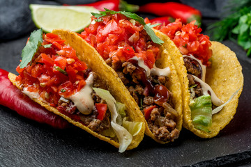 Mexican tacos with beef and salsa